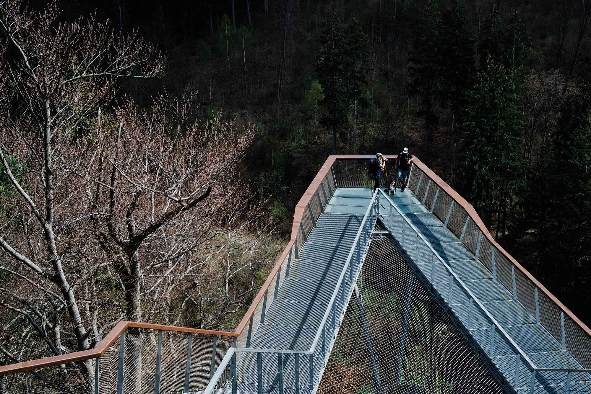 A man and woman stand on the Drachenfelsen Observation Deck in Innsbruck, Austria