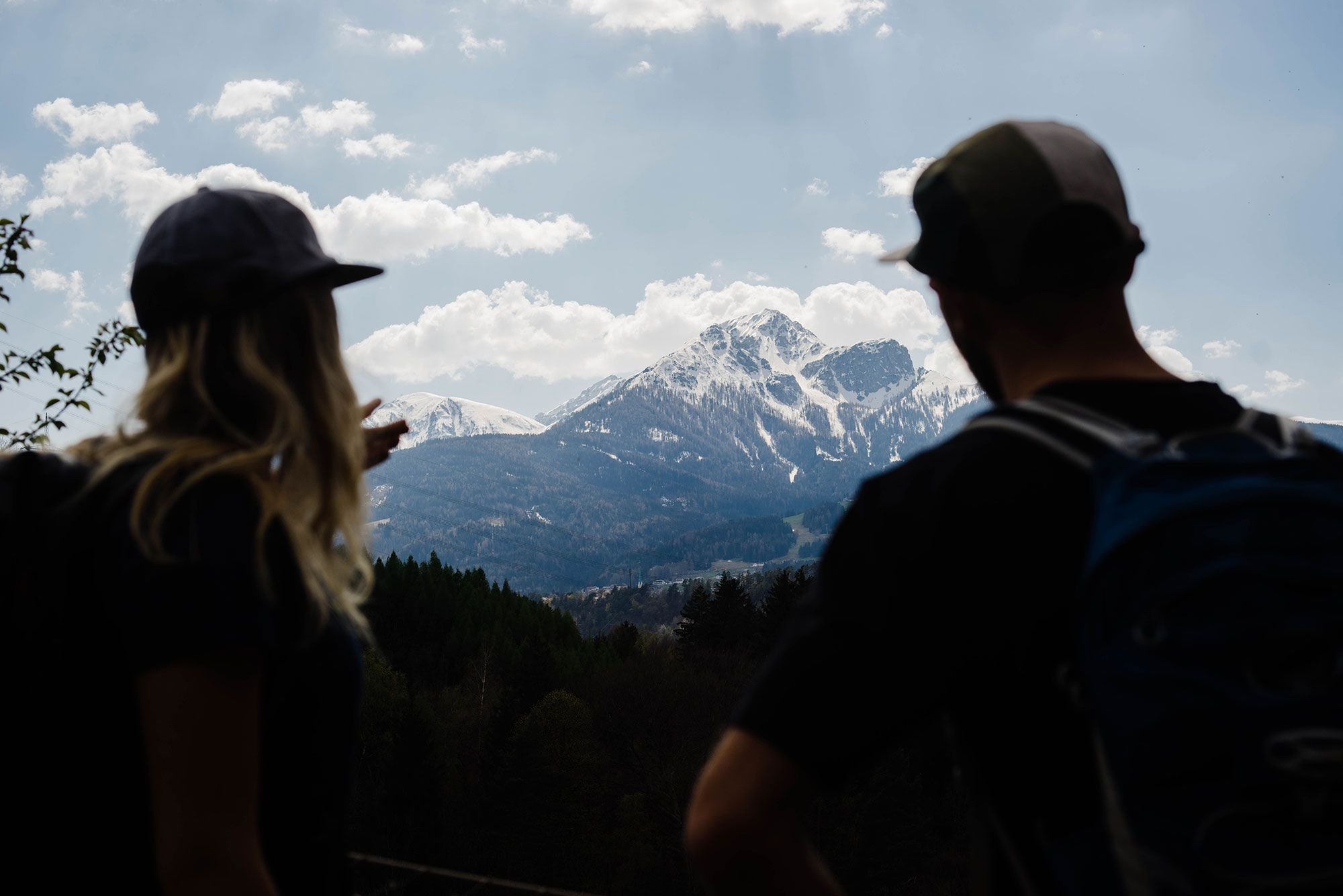 A man and woman look at a mountain range in Innsbruck, Austria